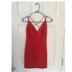 Red knit mini dress with cross strap back